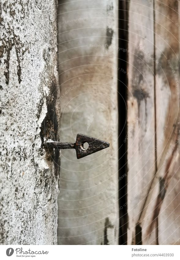 Lost Place - a wrought iron arrow protrudes from an old wall. lost place Wall (building) Wall (barrier) Old Deserted wrought-iron Arrow Point Hollow triangular