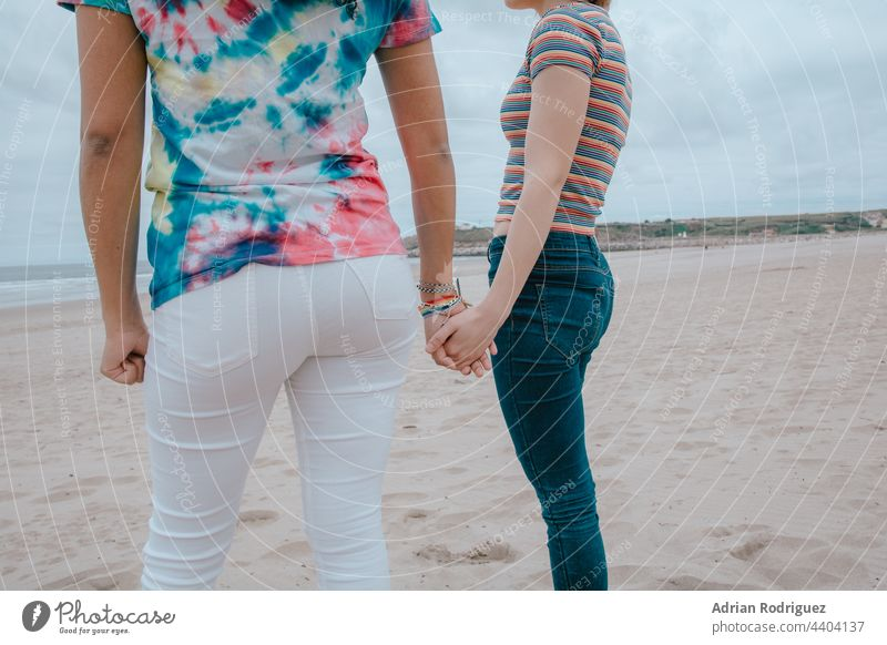 Two women holding hands - picture Participation lesbian Couple gay lesbians sexy photo LGBTQ bisexual Shorts Prey Girl two Hand Woman Family Lifestyle
