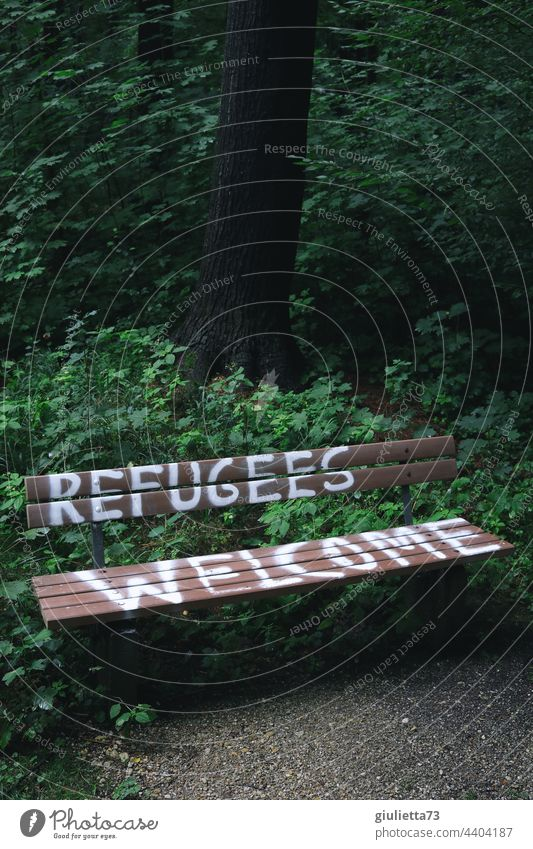 Refugees welcome   Lettering on a bench Graffiti Exterior shot Park Bench writing Characters Deserted Welcome human Humanity refugees welcome Hospitality