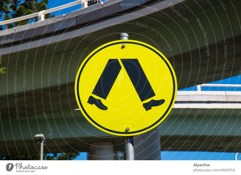 Footpath to the BVB Stadium Lanes & trails Signs and labeling Deserted Signage Transport Traffic infrastructure Street Pedestrian Town Day Yellow Road sign