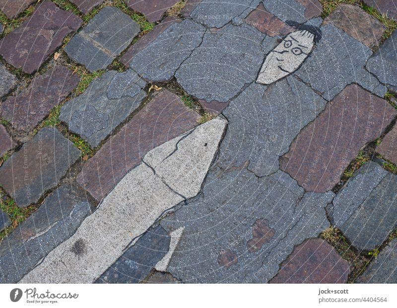 "Remainder of the ground marking ""Pedestrian Pedestrian crossing Cobblestones Weathered Street Traffic infrastructure Street art Comic Prenzlauer Berg Berlin"