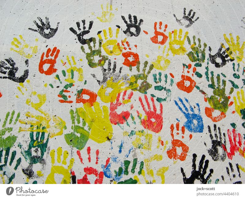 studded | with handprints in bright colors Hand Street art Imprint Many Creativity Teamwork Multicoloured Silhouette Agreed Abstract Structures and shapes