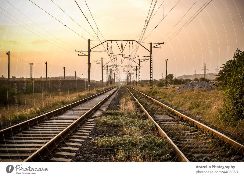 View of a railway during sunset. background blue concept day direction electrical hdr horizon industrial industry infinity iron journey landscape line metal