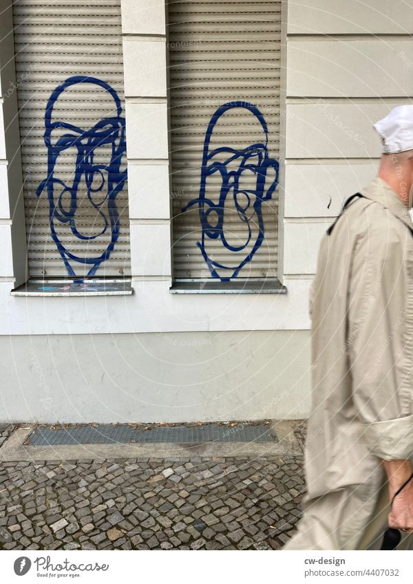 Two faces and one without - drawn & painted Graffiti urban Faceless City Exterior shot Summer Street Hip & trendy Daub character face of character Style