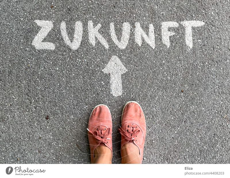Person stands in front of an arrow pointing to the future Future authored Arrow Direction Future plans Orientation Trend-setting person feet Word Road marking