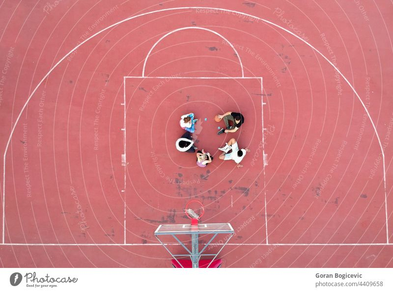 Above view of determined basketball playersstanding on court at daytime aerial background college competition field game grass green men outdoor outside person