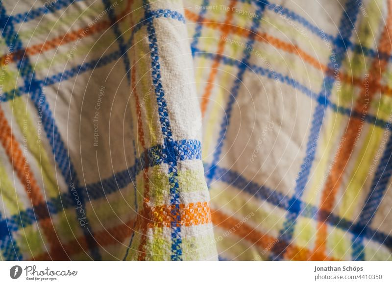 Checkered tea towel or kitchen towel Tea towel Rag Wipe Towel Blanket Cloth Textiles Pattern White Blue Orange Yellow crease Interior shot Structures and shapes