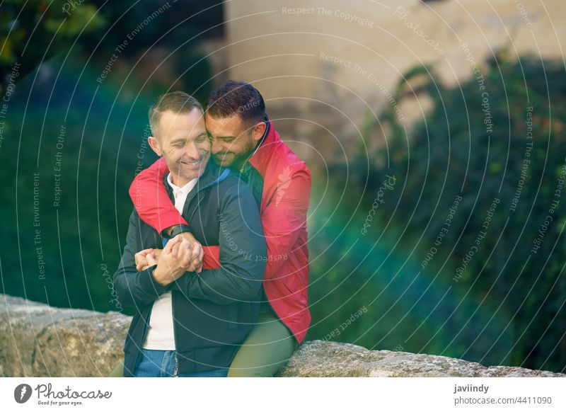 Gay couple in a romantic moment outdoors gay laugh laughing male love homosexual lgbt lgbtq relationship lovers albaicin granada boyfriend people adult happy