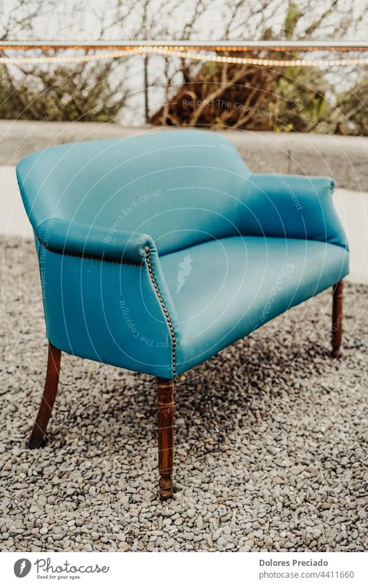 Picture of a vintage blue armchair accessories apartment architecture background beautiful bench chair set coffee table comfort contemporary couch cozy decor