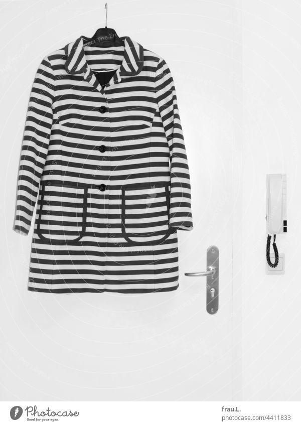 streaked Coat Summer coat Wall (building) Fashion Clothing door Intercom system Light switch
