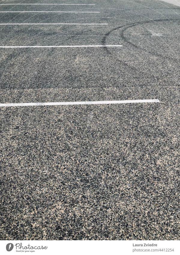 The empty carpark car park Parking lot Parking area Traffic infrastructure Asphalt Street Line Empty Signs and labeling Gray Traffic lane Lanes & trails