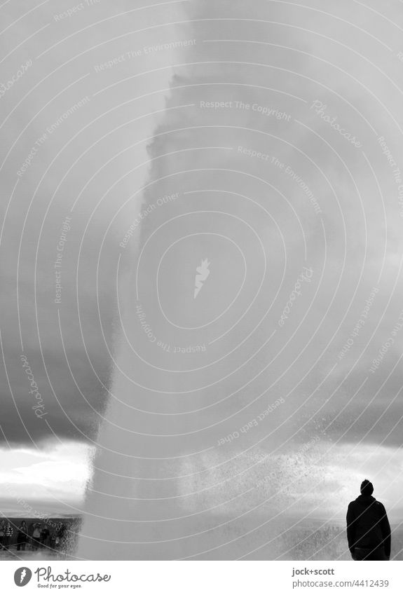 Eruption of the geyser with a spectator Geyser Nature Iceland Vacation & Travel Water Silhouette Tourist Black & white photo Sky Covered motion blur