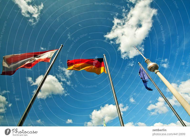 Fernsehturm mit wehenden Fahnen again alex alexanderplatz architektur berlin city deutschland fernsehturm froschperspektive funk-und-ukw-turm hauptstadt himmel