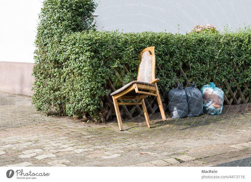 roadside bulky waste Exterior shot Sidewalk Dispose of Colour photo Hedge Wooden chair Broken Trash nobody Bulk rubbish Roadside Chair Chair leg Fence