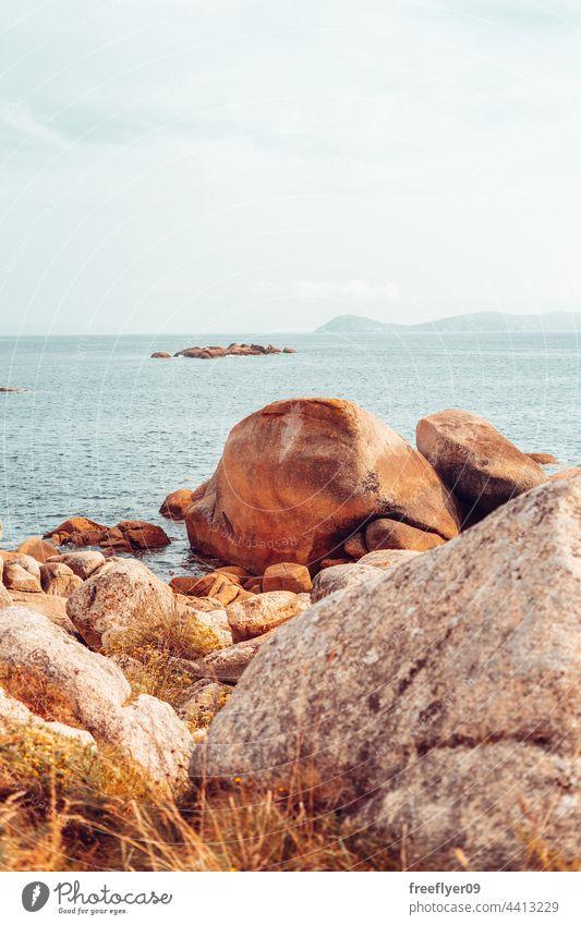 Landscape of a mediterranean coastline sea seascape rocks granite horizon copy space nobody beach scenic landscape day cliff nature water ocean travel storm