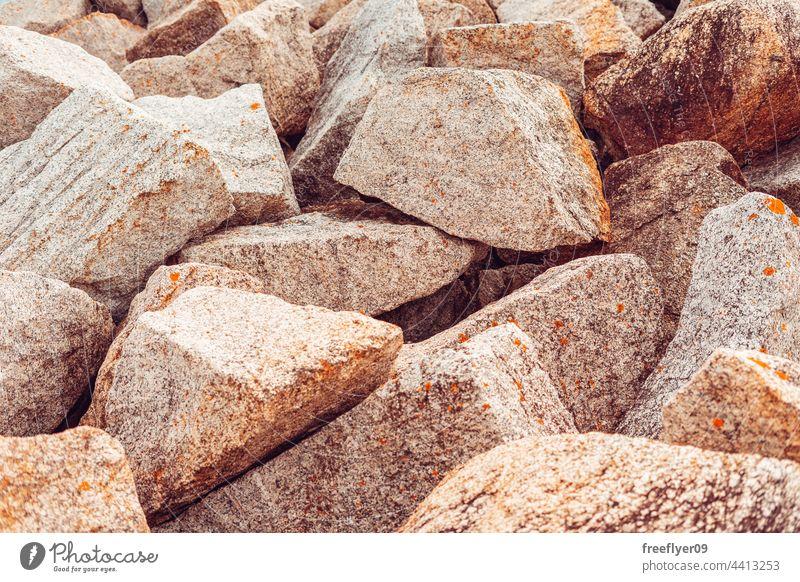 big granite stones piled up rocks texture copy space mining mine collection wallpaper chunks artificial breakwater seawall shore horizon mountain blue coastline