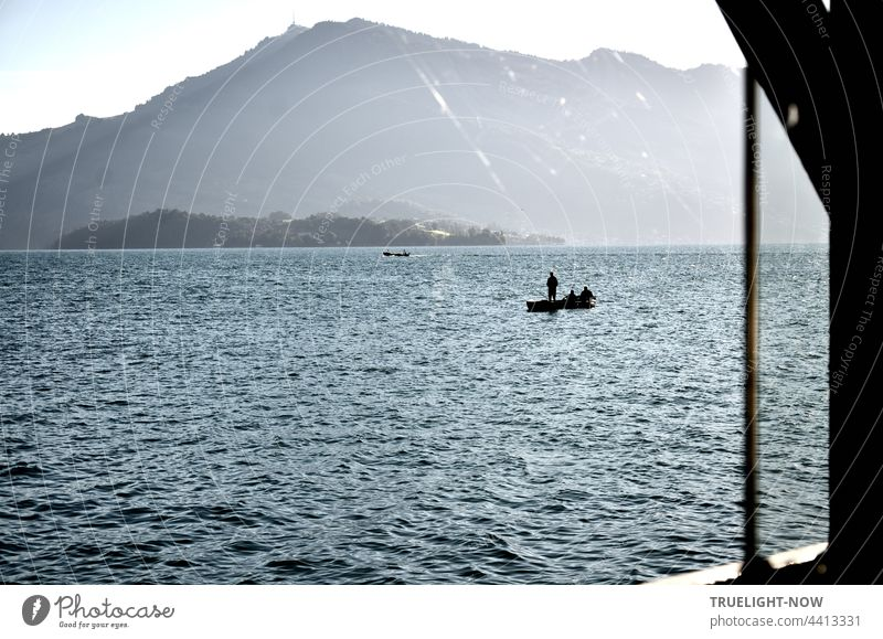 Anglers on the lake. The day has hardly begun. Petri heil I think. Lake Lucerne Switzerland mountains holidays vacation Fishing (Angle) boat boats Fishing boat