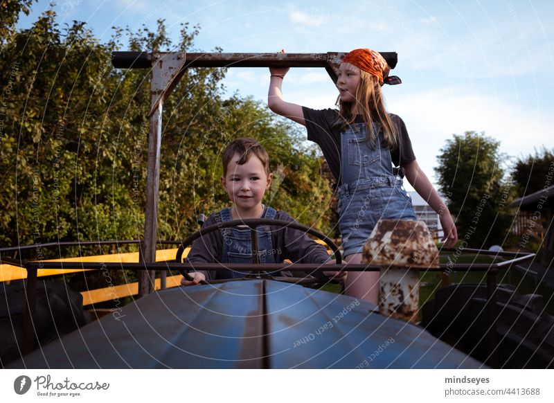 Children playing on the tractor Farm Tractor Tug Infancy Playing Driving Agriculture Nature Vehicle agriculturally Farmer farm holidays Childhood dream Field