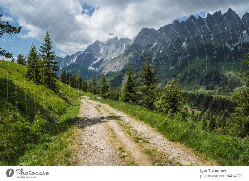 Hiking trail around Wilder Kaiser mountains, Tirol - Austria tirol austria kaiser wilder path landscape ellmau europe summer alps nature green clouds road