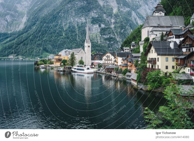 Famous lake side view of Hallstatt village with Alps behind, Foliage leaves framed. Austria hallstatt austria alps famous town landscape nature tourism