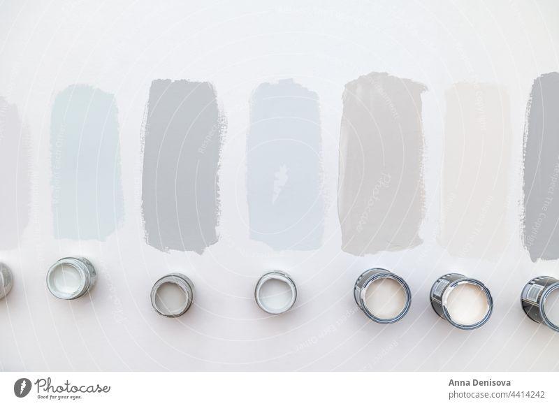 Choosing wall paints can brush pots sample choosing renovation sample pots color grey pastel plastered liquid tin bucket home house decoration paintbrush dye