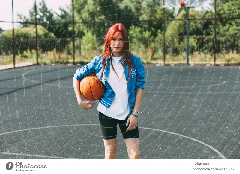 Portrait of a smiling teenage girl with a basketball on the sports field. Sports, health, lifestyle playground holding portrait player active activity leisure