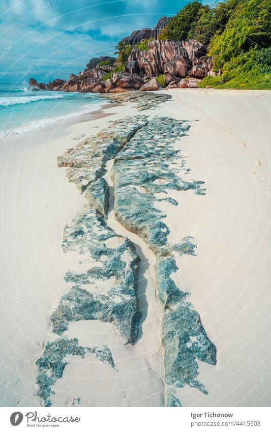 Tropical beach at Grand Anse, La Digue island, Seychelles. Beautifully shaped granite boulders, white sand and blue ocean digue la digue anse paradise travel