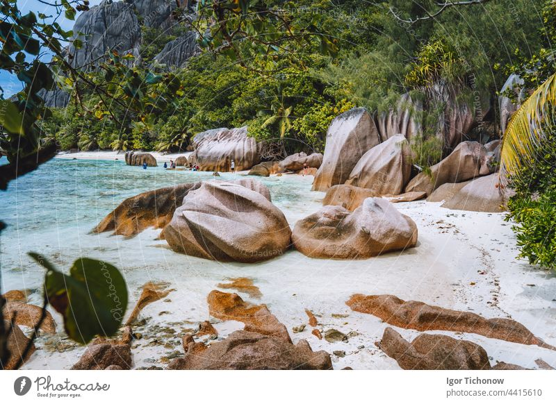 La Digue, Seychelles. Hiking tour around tropical exotic paradise island with granite boulders and coconut palm trees beach seychelles digue sand ocean tourism