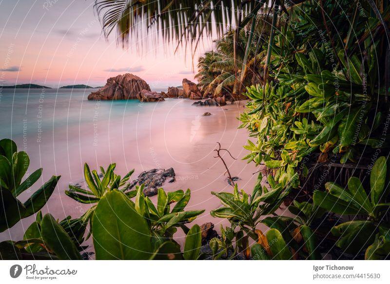 Paradise exotic beach on La Digue Island, Seychelles. Long Exposure during amazing sunset long long exposure light digue island paradise seychelles anse