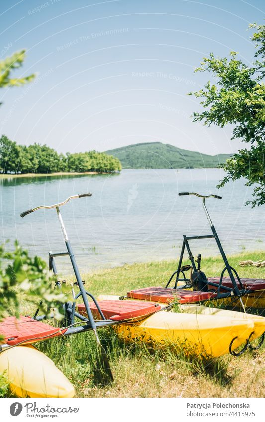 Water bikes by a lake in the summer water bike water bicycles leisure recreation sports fun