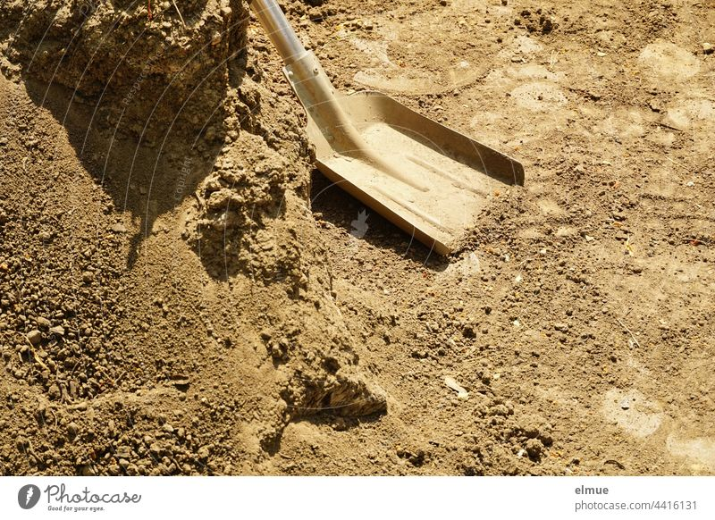 Shovel blade with metal handle and a mountain of gravel / Tools / Construction work shovel handle Gravel footprint construction Handcrafts Build