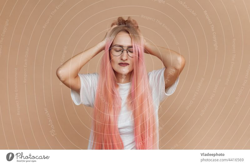unhappy tired caucasian young woman touching her head and suffering from headache female stress portrait care closed beauty person indoors eyes girl face people