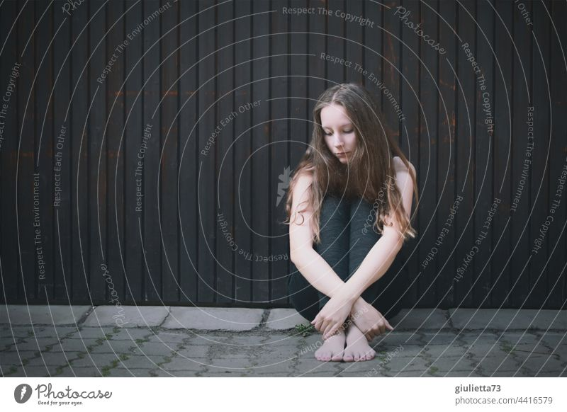 Portrait of a teenage girl, sitting outside on the ground, alone, sad, hopeless portrait Lovesickness Sadness Longing Grief Disappointment Loneliness Pain