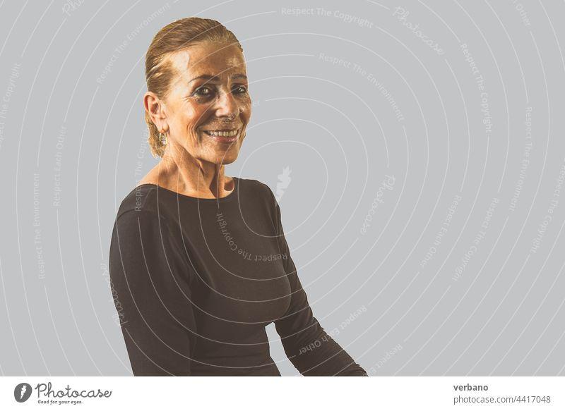 senior elegant lady dressed in black in grey background portrait female mature old elderly adult happy lifestyle woman retired hair smile people caucasian