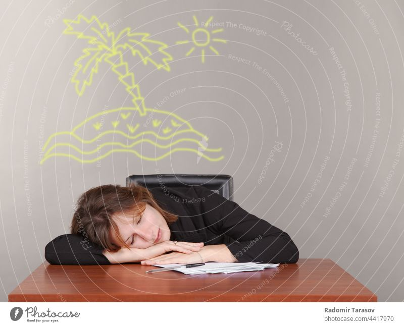 business woman sleeping at a desk businesswoman office female table tired work job people young professional adult workplace beautiful overworked girl lady