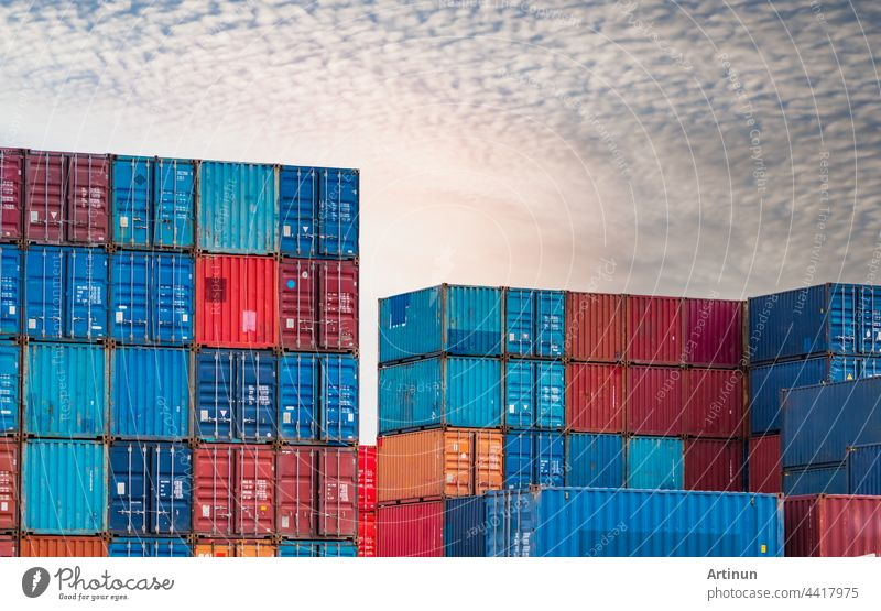 Container logistic. Cargo and shipping business. Container ship for import and export logistic. Container freight. Logistic industry. Blue and red container against white sky for truck transport.