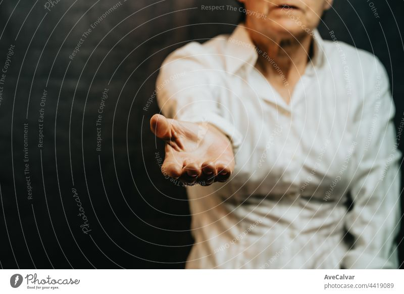 Old woman giving hands to the camera, help and self help concept, mental health advice assistance guidance husband listening meeting patient psychotherapy