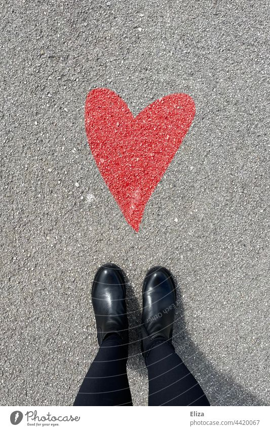 Person stands in front of a painted red heart on asphalt Heart Red Asphalt Street person Love Emotions Romance Infatuation Painted Chalk