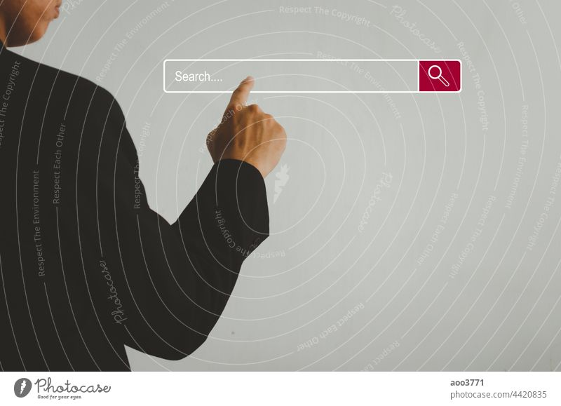 Businessman is touching a search on a virtual screen.Searching information network concept with copy space. internet search page computer touch screen. business