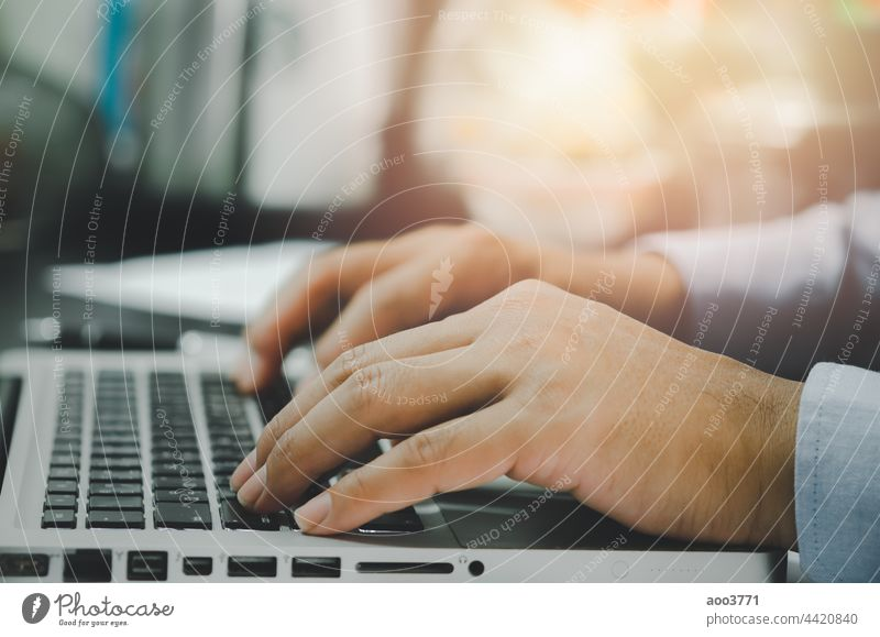 man hand using computer laptop on table at home technology office typing communication people business online browsing network notebook job keyboard male
