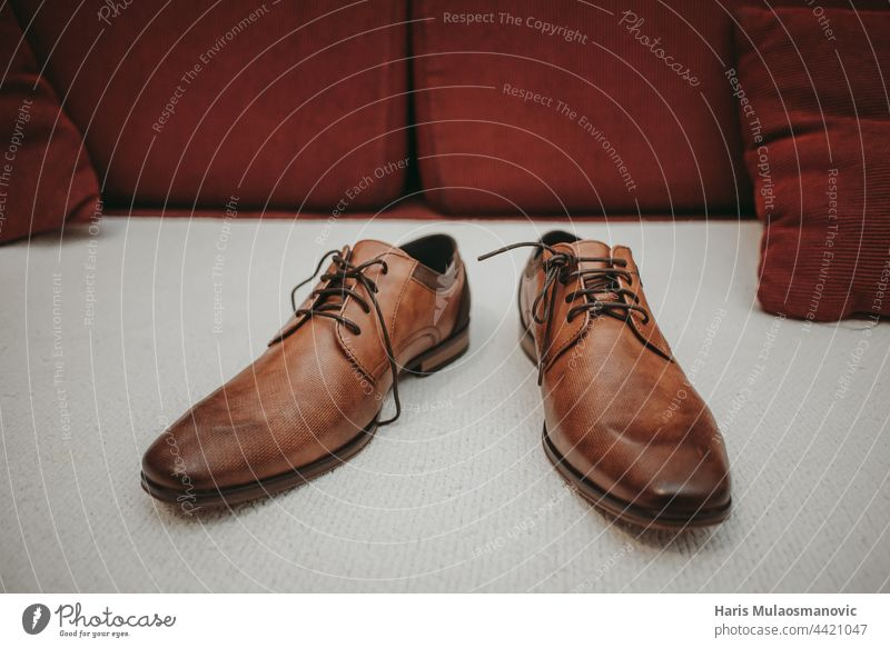 brown leather wedding shoes on the sofa accessory background boot brown shoes business buying carpet casual classic clothes clothing collection comfortable