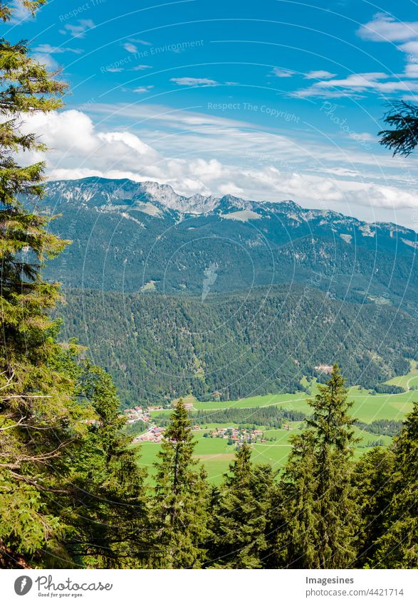 Landscape of the Bavarian Prealps in Germany, Europe, village Bäcker. View from the mountain Staffel. Mountain range Bavaria Alps. vertical image