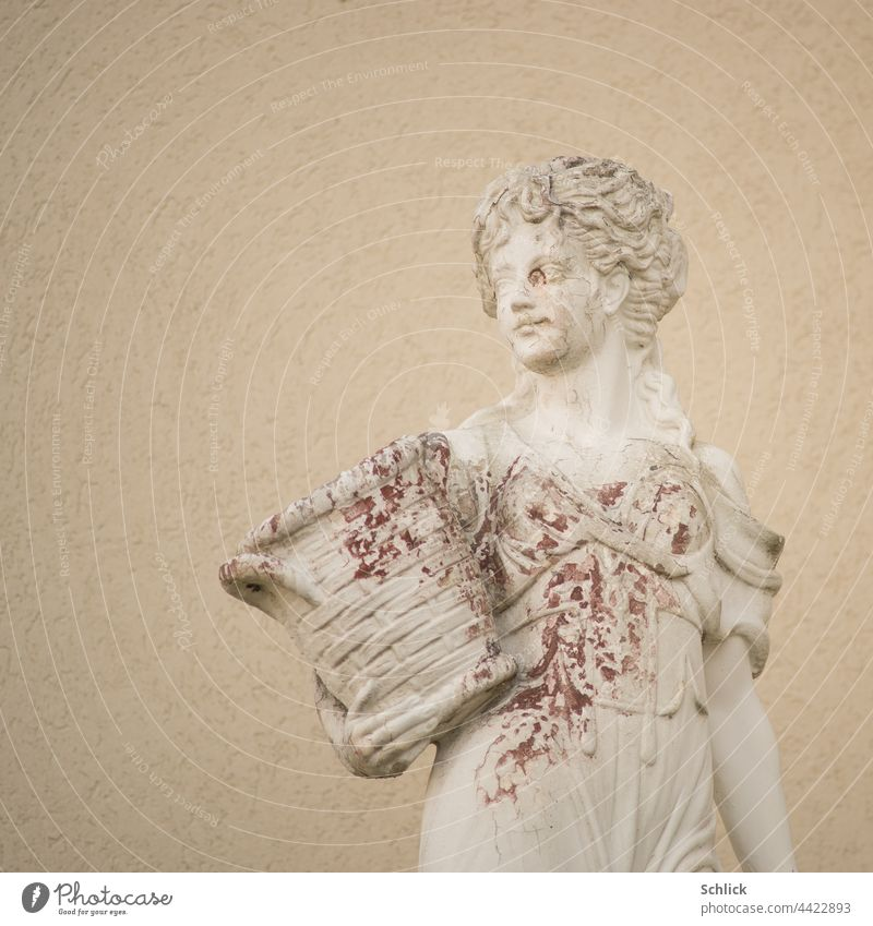 Beauty with stains female statue of light concrete with color peeling and red algae Statue Woman Bright blotch Brown Beauty & Beauty Brown algae blotchy