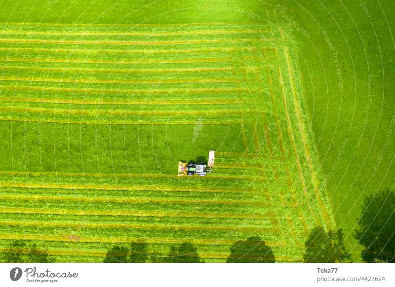 Tractor mowing a #field Field farm Agriculture from on high Meadow Hay modern tractor tractor mows