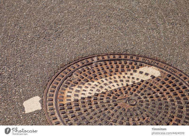Danish manhole cover Manhole cover Metal Heavy Street Asphalt nap color strip Rust Deserted Exterior shot din norm