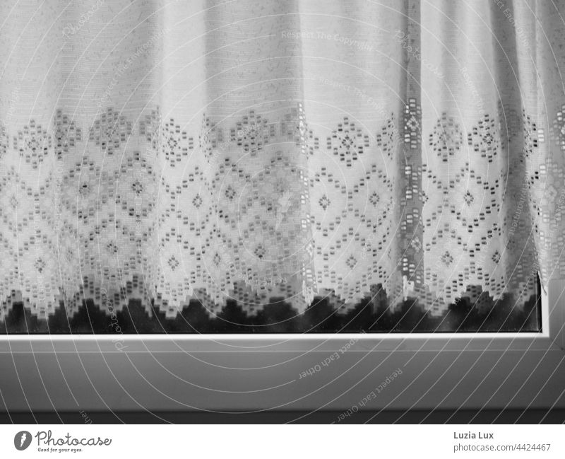 An old fashioned curtain behind closed window Moody Textiles Closed shape Drape at the window Window drapes Light Curtain Shadow Bright White Flat (apartment)