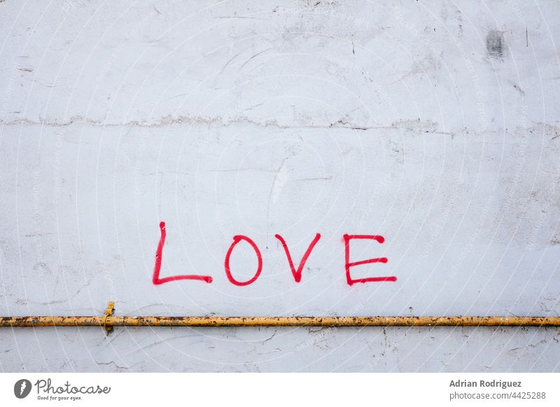 Text Love in Wall Wall (building) Graffiti Characters Wall (barrier) Emotions Declaration of love Romance With love Display of affection Exterior shot