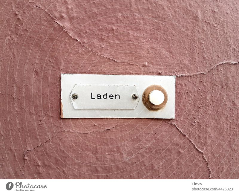 Bell button with inscription shop on old pink wall bell button bell shield Load Facade Deserted Old House (Residential Structure) Wall (building) dusky pink