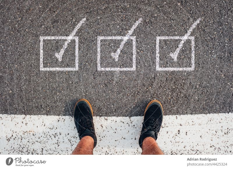 Person stands in front of three check box with symbol Checkmark vote correct sign approved tick icon button yes checklist right choice voting simple white
