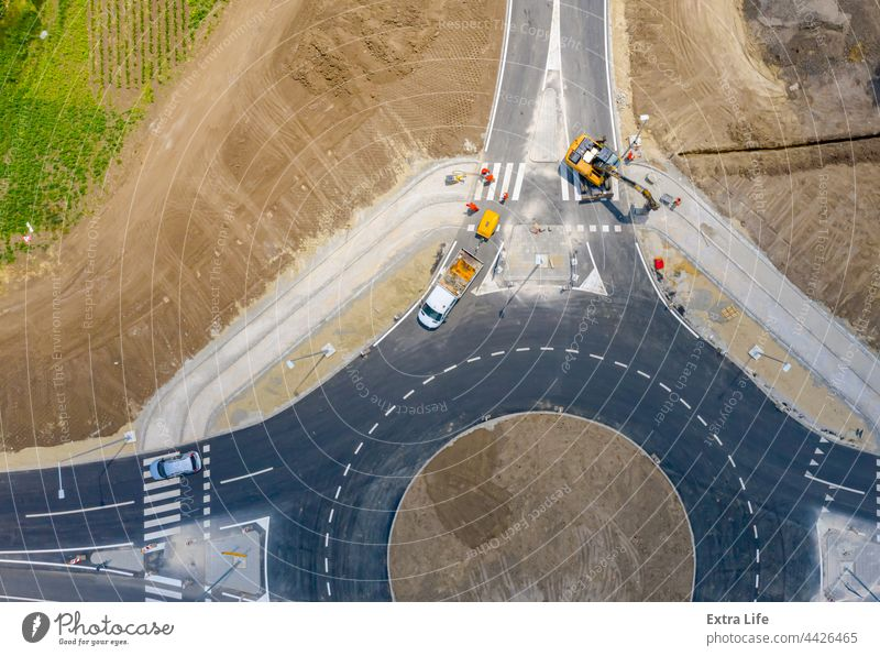 Aerial view over construction site, finishing work, new traffic roundabout Above Active Architecture Asphalt Building Site Car Circular Civil Engineering